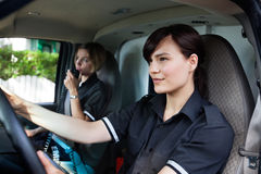 Female Paramedic Driving Ambulance Stock Images