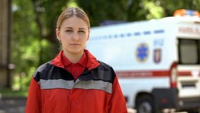 Female paramedic posing for camera, professional emergency medical service royalty free stock photography