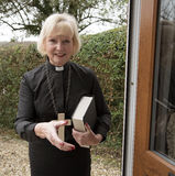 Female parish priest on a house call Royalty Free Stock Image