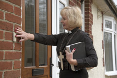 Female parish priest on a house call Royalty Free Stock Photography