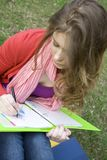 Female in the park draws Stock Photography
