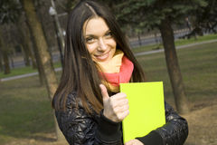Female in the park with a folder Royalty Free Stock Photo