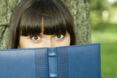 Female in a park with a notebook Stock Images