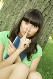 Female in a park with a notebook Stock Photo