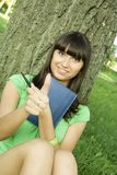Female in a park with a notebook Royalty Free Stock Image