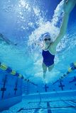 Female Participant Swimming Underwater Stock Photo