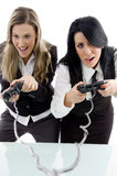 Female partners playing game and holding remote Royalty Free Stock Photo