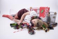 Female party goer sleeping on floor Stock Photo