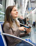 Female passanger reading from mobile phone screen Royalty Free Stock Image