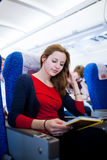 Female passenger on board of an aircraft Royalty Free Stock Images