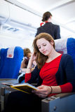Female passenger on board of an aircraft Stock Photo