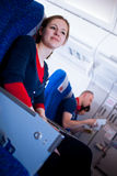 Female passenger on board of an aircraft Royalty Free Stock Photography