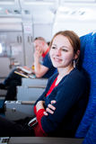 Female passenger on board of an aircraft Royalty Free Stock Photos