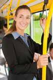 Female passenger in a bus. Presumably she is heading home Royalty Free Stock Photography