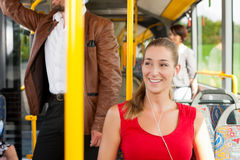 Female passenger in a bus. Presumably she is heading home Royalty Free Stock Image