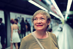 Female passenger riding underground Stock Photo