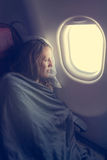 Female passenger sleeping covered with blanket. Royalty Free Stock Photos