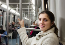 Female passenger in subway train Royalty Free Stock Image