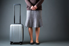 Female Passenger and a Suitcase Stock Photography