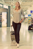 Female passenger with travel bag. Royalty Free Stock Images