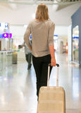Female passenger with travel bag. Royalty Free Stock Photography