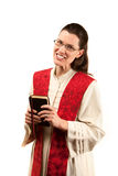 Female Pastor. In robe and red stole on white background stock images