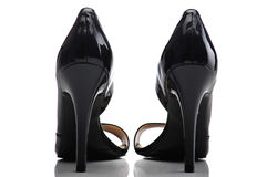 The female patent leather shoes on a white background Stock Photos