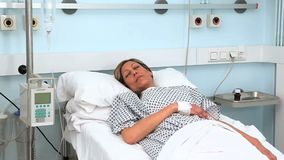 Female patient asleep on a medical bed Stock Images