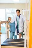 Female Patient Being Assisted By Nurse Royalty Free Stock Photo