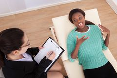 Female patient conversing with psychologist Stock Images