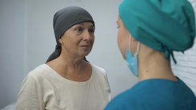 Female patient crying learn about unsuccessful chemotherapy, advanced cancer. Stock footage stock footage