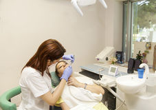 Female patient at dentists office Stock Image