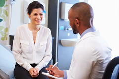Female Patient And Doctor Have Consultation In Hospital Room stock photography