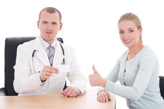 Female patient and doctor holding visiting card Royalty Free Stock Photography