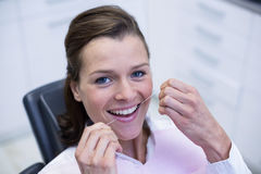 Female patient flossing her teeth Stock Images