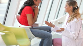 Female Patient Getting Good News From Doctor