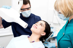 Female patient have x-ray examination. Male dentist takes an x-ray of an women teeth stock photography