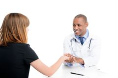 female patient having consultation with african american doctor, royalty free stock photo