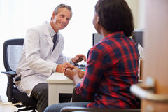 Female Patient Having Consultation With Doctor In Office Royalty Free Stock Photography