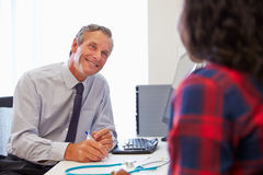 Female Patient Having Consultation With Doctor In Office Stock Image