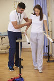 Female Patient Having Physiotherapy In Hospital Stock Image