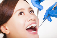female patient having  teeth examined by dentist Stock Photography