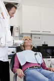 A female patient having an x-ray at the dentist Stock Image