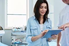 Pretty woman having consultation with plastic surgeon stock image