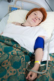 Female patient in hospital bed Stock Image