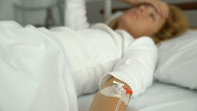 A female patient in a hospital ward with a drip stock video footage