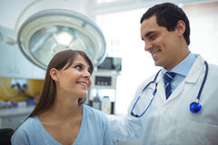 Female patient interacting with doctor during visit. In the hospital Stock Images