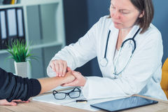Female patient at orthopedic doctor medical exam for wrist injur Stock Photography