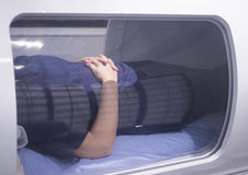 Female patient in oxygen hyperbaric chamber HBOT Royalty Free Stock Image
