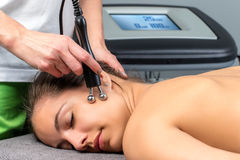 Female patient receiving electrotherapy therapy on face. royalty free stock images